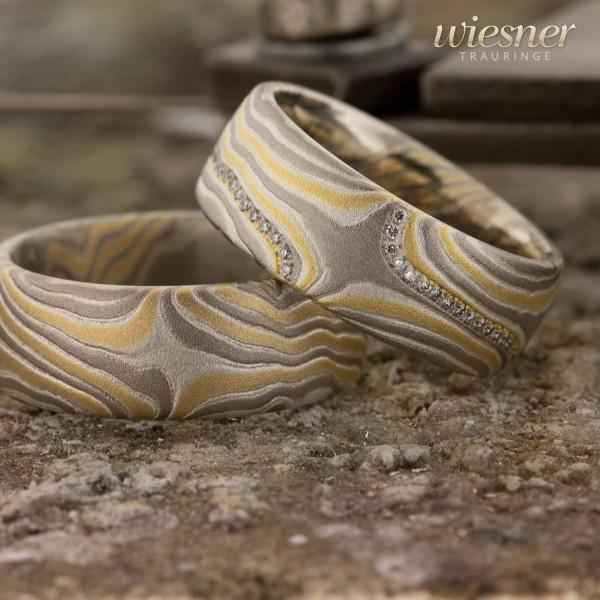 Mokume Gane Trauringe Limba in Gelbgold, Palladium und Silber mit lupenreinen Diamanten
