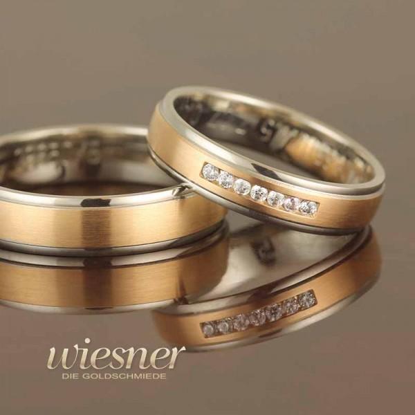 Trauringe Gerstner in sattem Gold und Weißgold mit 7 Diamanten