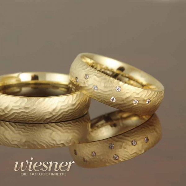 Gerstner wedding rings in structured yellow gold with diamonds