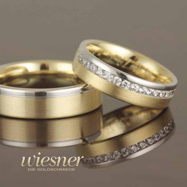 Trauringe Gerstner in Bicolor mit einer Reihe Diamanten gefasst