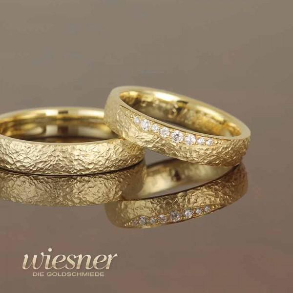 Eheringe Gerstner in Gelbgold mit stone pattern und Diamanten